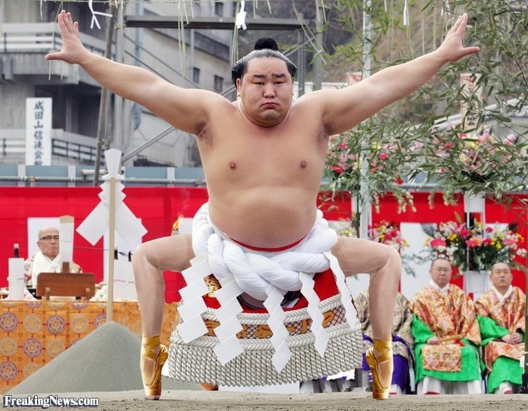 Sumo grand champion Asashoryu of Mongolia performs sacred ring-entering ritual at Naritasan Shinshoji temple in Narita, east of Tokyo